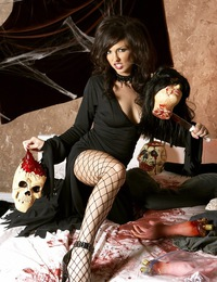 Franchezca Valentina is ghoulishly sexy slitting her fishnets and bra with a bloody knife to get at her pussy and boobs in this scary holiday photo sh