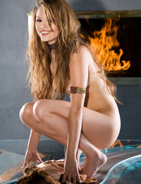 Nani Forrester warming her lovely naked Asian booty by the fireplace.